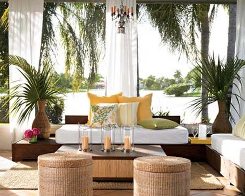 Sheer curtains are great for outdoor spaces; they seem tropical in the way they billow in the breeze.  I love them in combination with natural fibres, such as the rounded seats that double as storage. Image: interior-dsgn.com