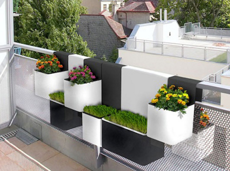 Container gardens can do more than add some much needed greenery.  In this case, they provide both great style and some privacy from those across the way. Image: eblander.com